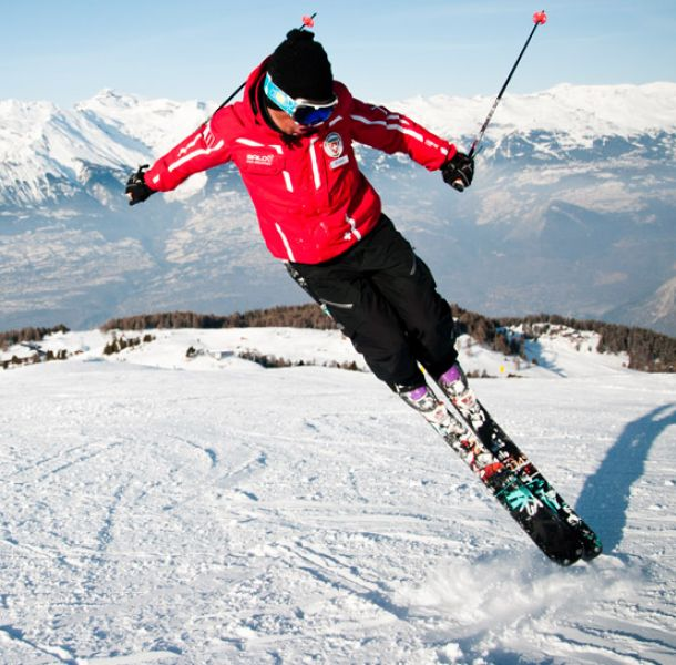 Learn the perfect style with your instructor at Veysonnaz swiss ski school